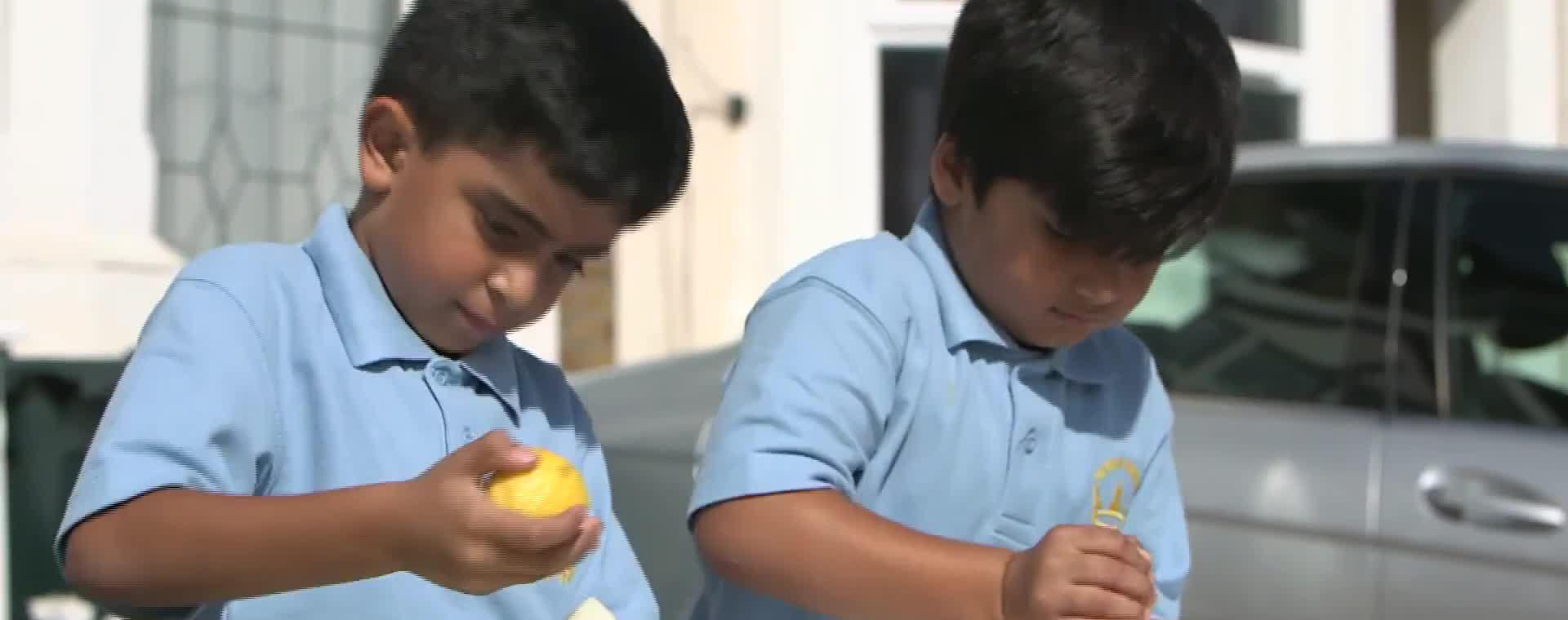 Angelina Donates To Lemon aid Boys